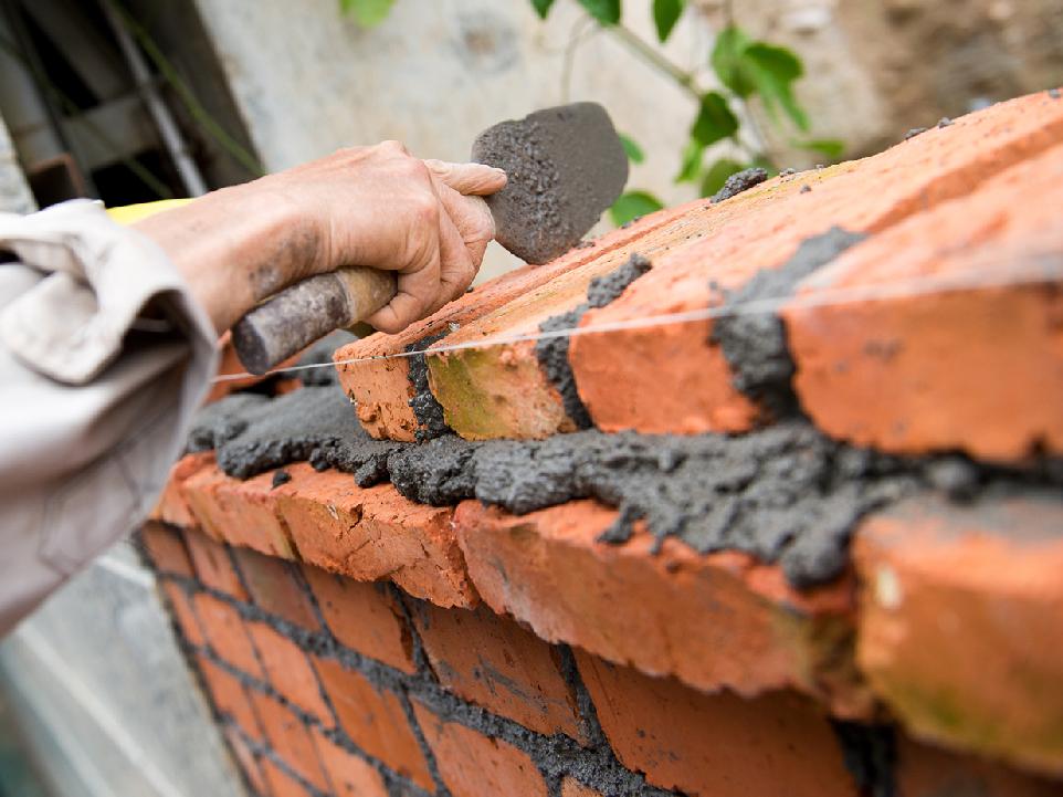 Brick laying bricklayer