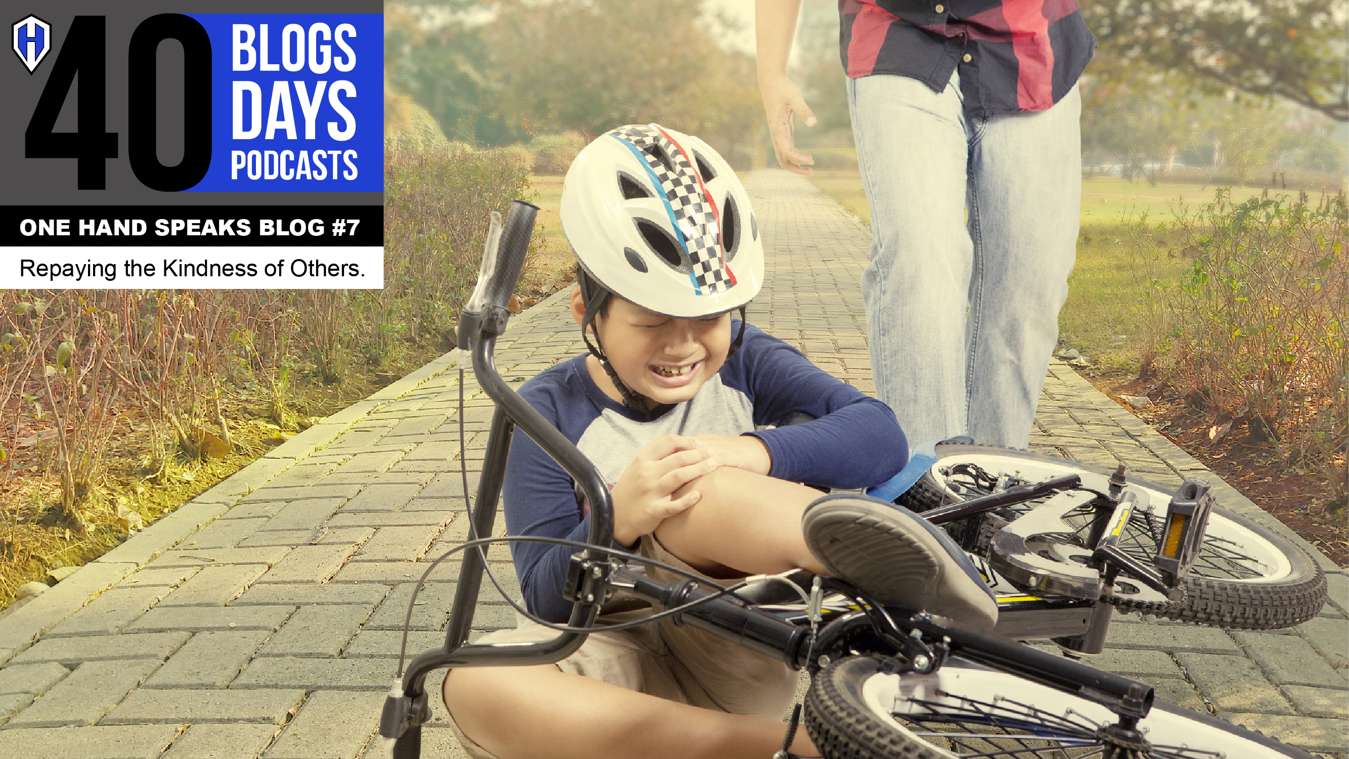 An image of a young boy who fell of his bike and was crying. A man in the background in coming to help.