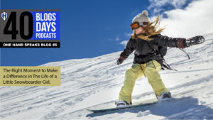 A young girl snowboarding
